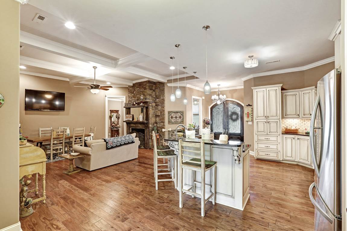 Featuring a coffered ceiling, recessed lighting an