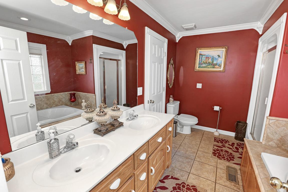 Features include tile flooring, double vanities, e