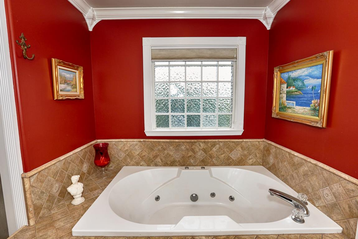 Whirlpool tub with custom tile surround.