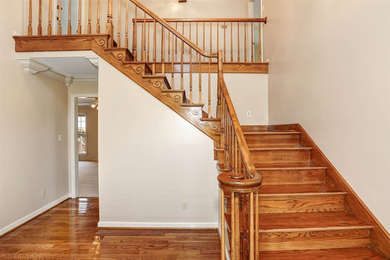 Home features beautiful staircase in foyer