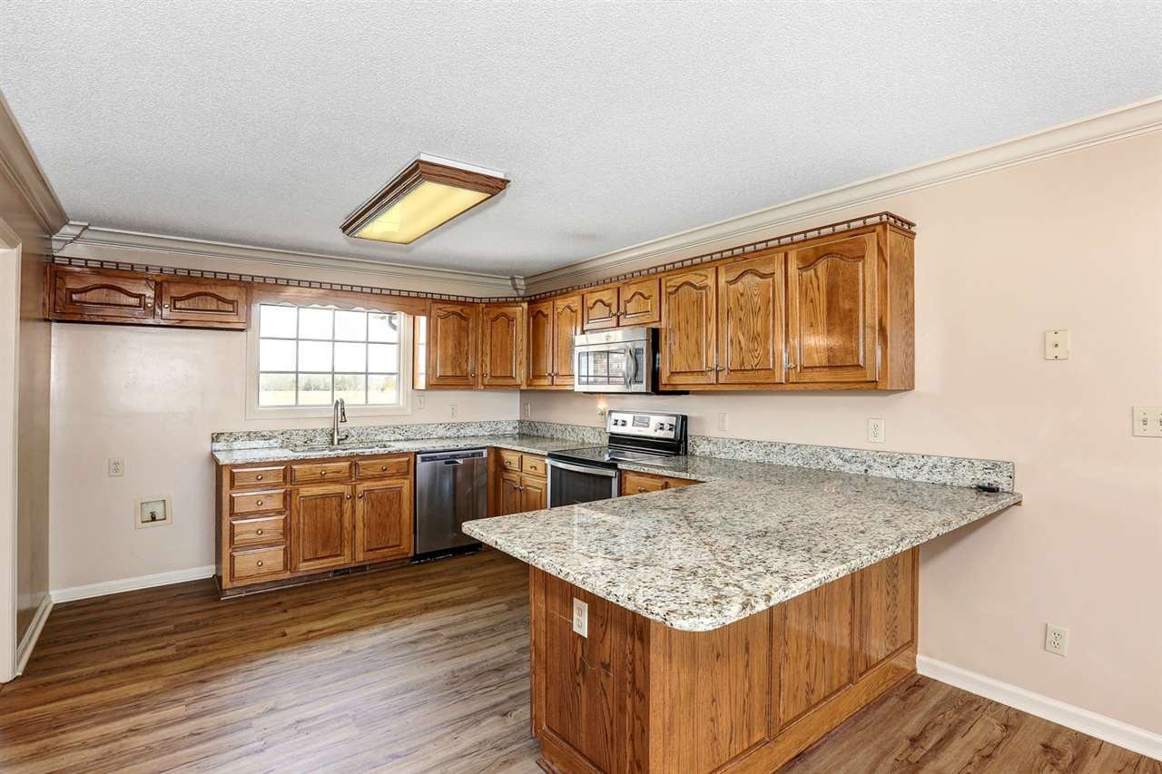 SS appliances and oak cabinetry