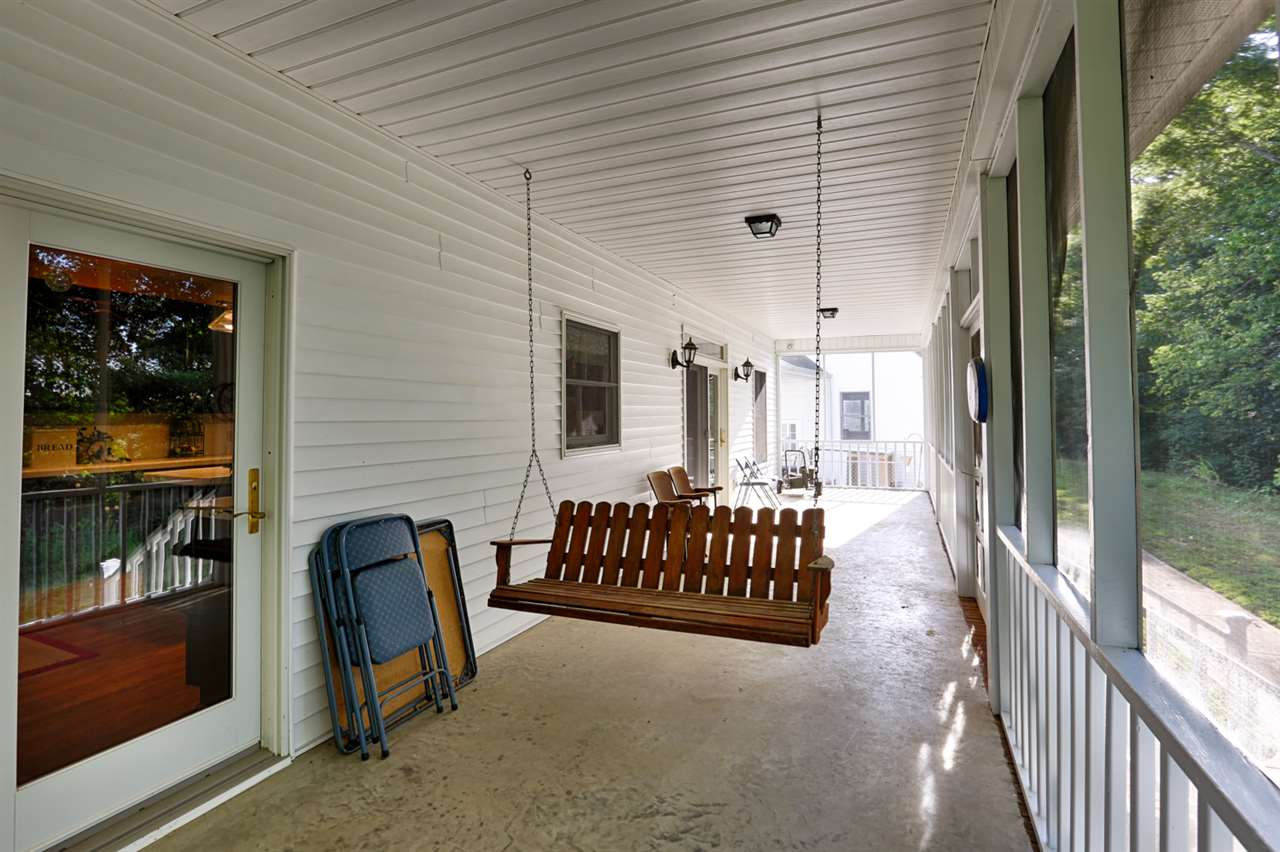 Large screened-in back porch