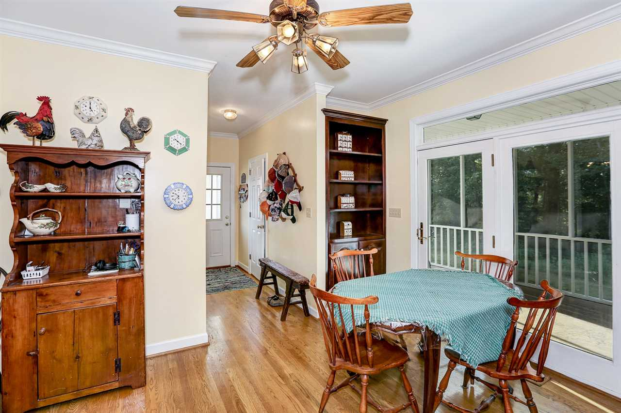 Ceiling fan, wood floors,  built-in cabinet