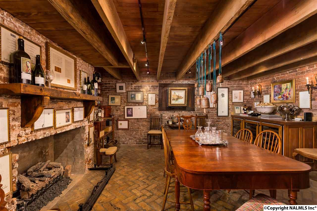 Exposed rough-hewn beam ceilings with large open h