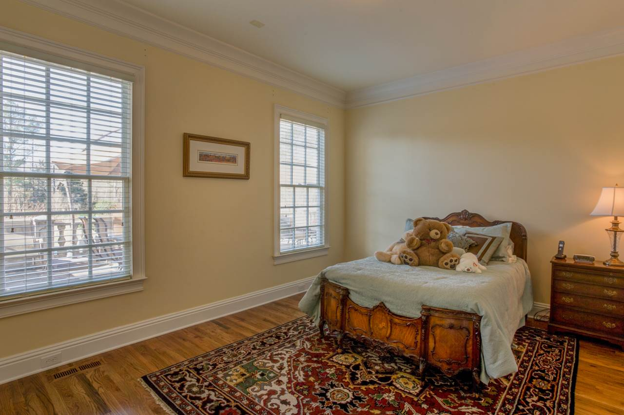 Second bedroom on main level with hardwood floors