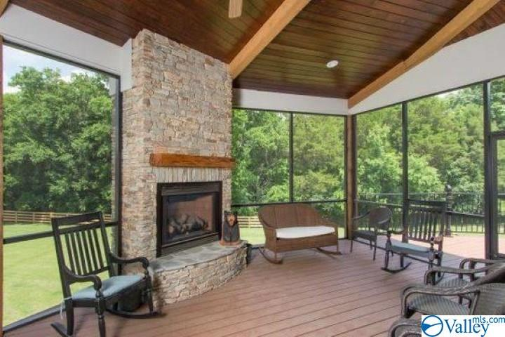 Screened in porch with fireplace, wood ceilings an