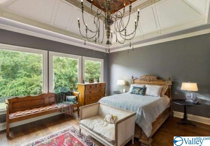 Master bedroom with trey wood ceilings and crown m