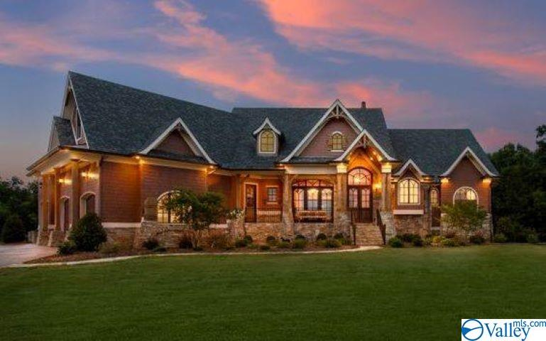 Exterior lighting of the home at sunset.