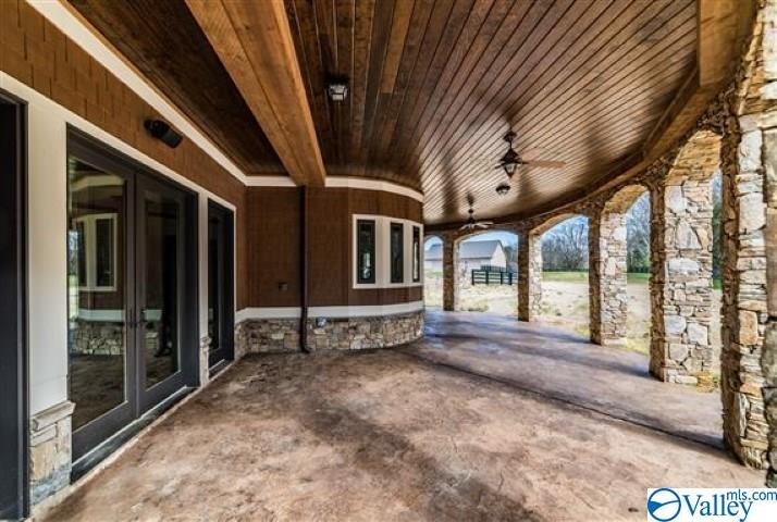 Basement walk out covered patio with wood ceilings