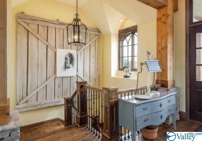 Foyer with custom barn door decor that remains wit