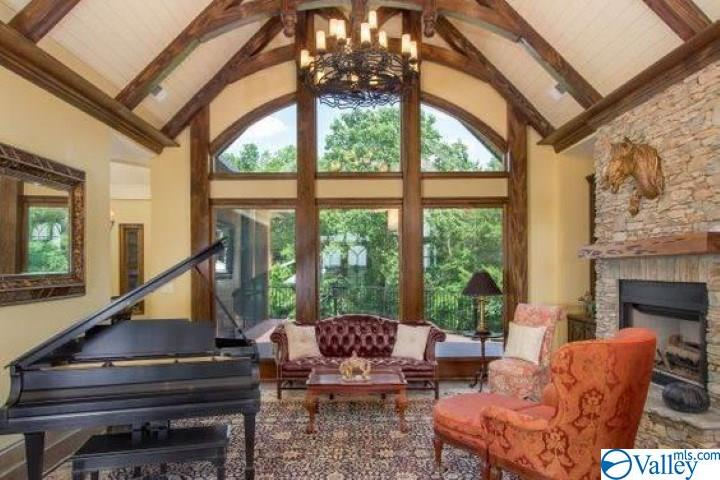 Living room with fireplace and views! Vaulted ceil