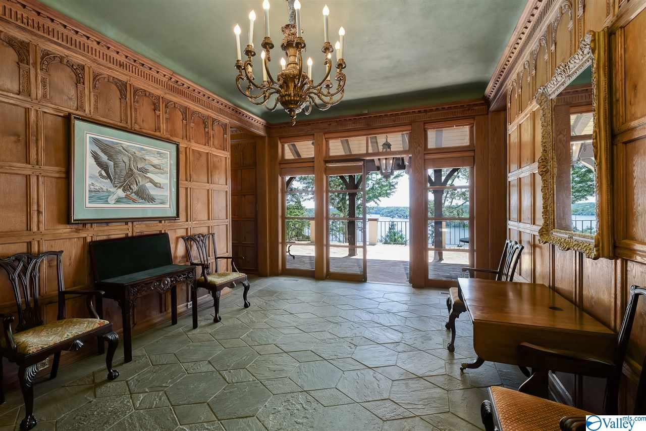 The main entrance leads to a spacious foyer with 1