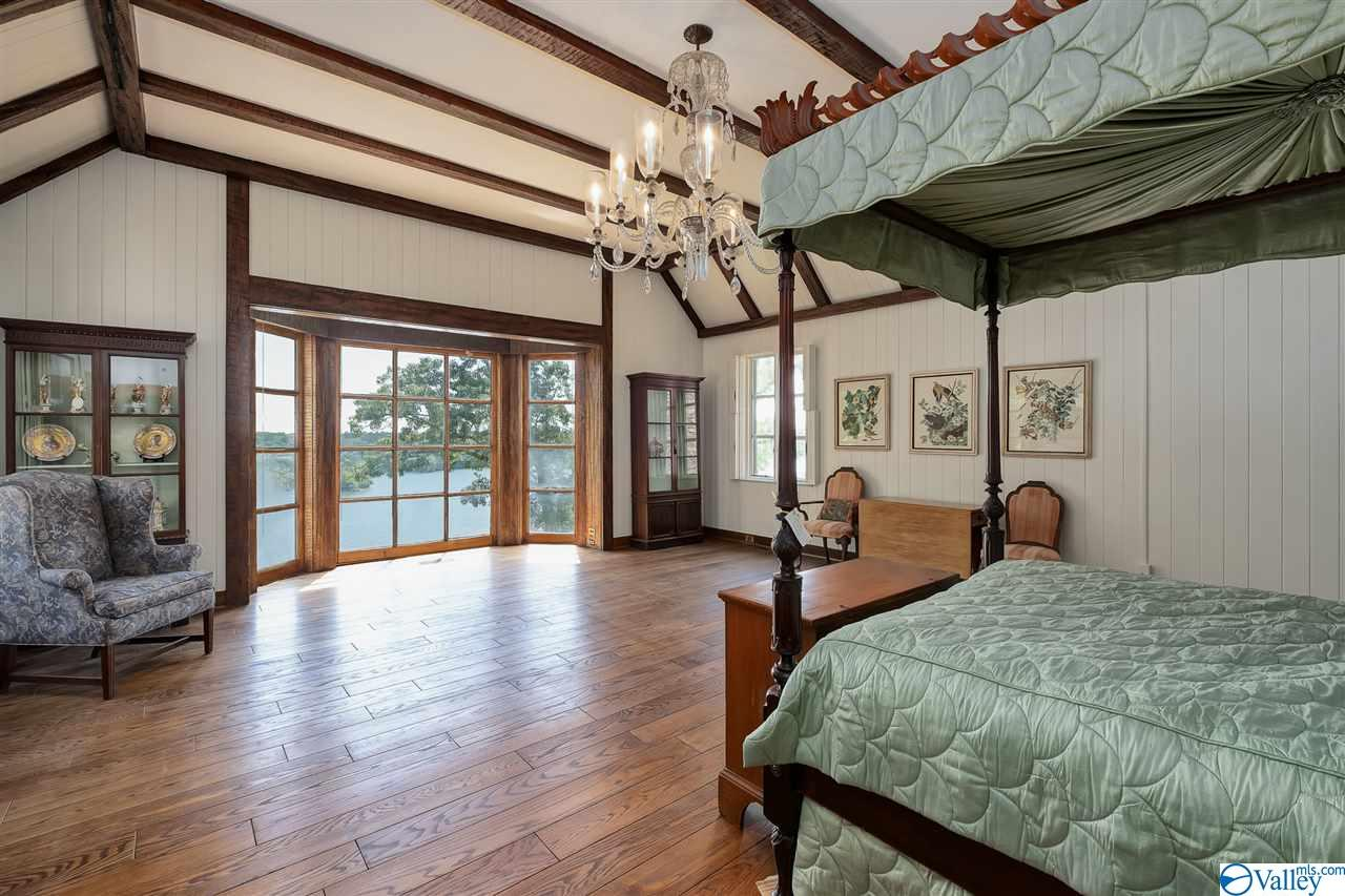 Master bedroom with vaulted wood beam ceiling and