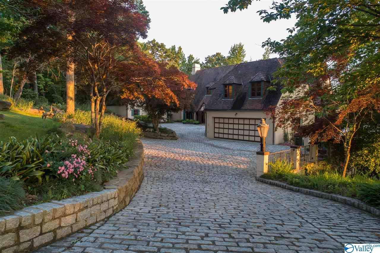 Expansive cobblestone courtyard and driveway