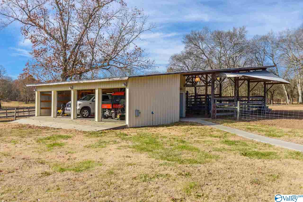 Four bay garage with attached cattle working facil