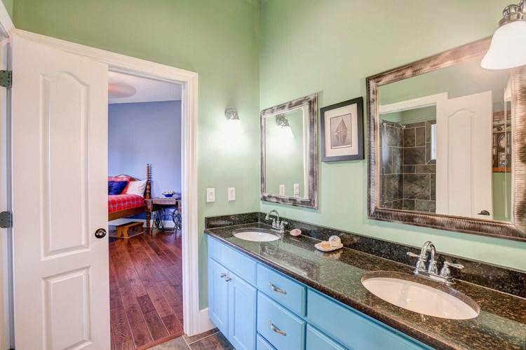 granite double vanity / jack & jill style bathroom