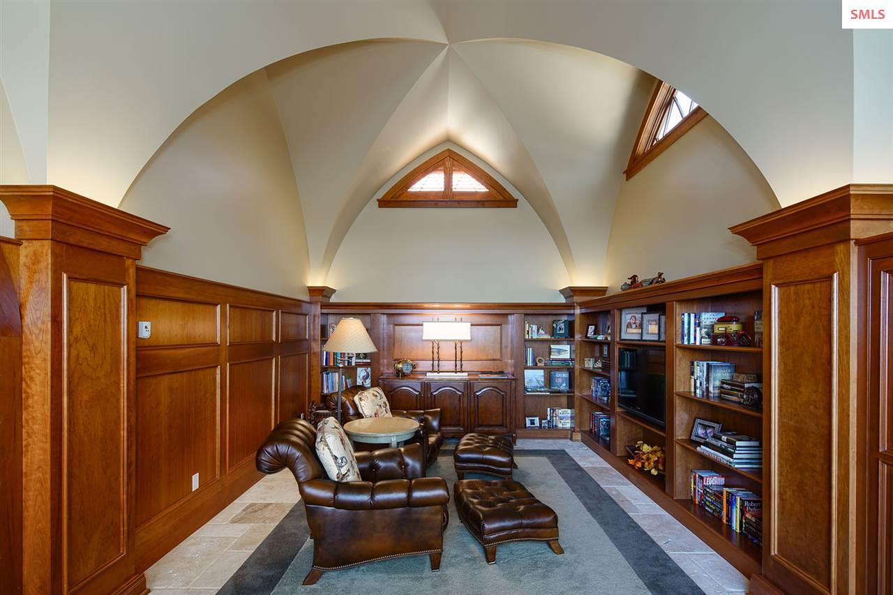 Curved ceilings and Cherry cabinets create an eleg