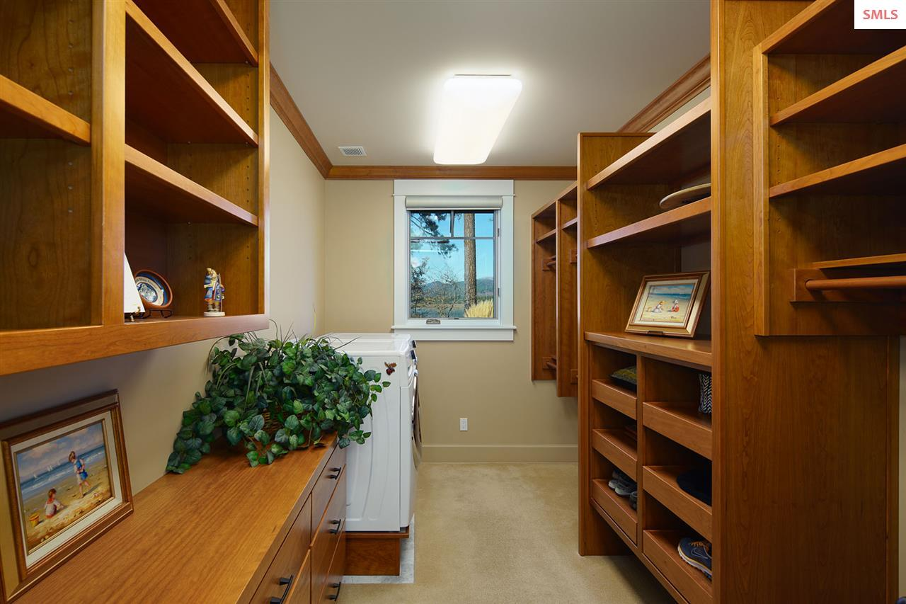The larger of two walk in closets has an opening