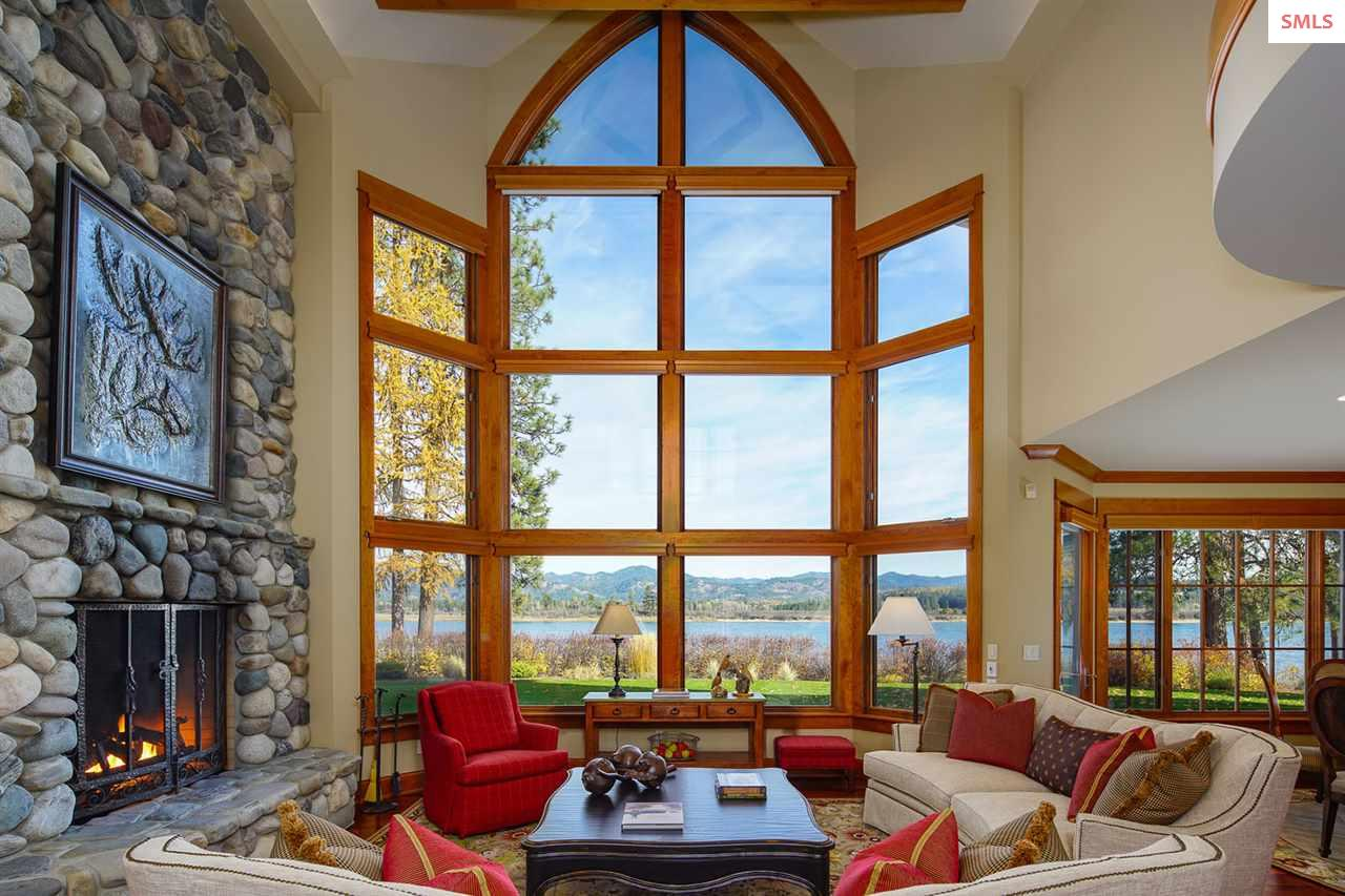 Floor to ceiling stone gas insert fireplace with a