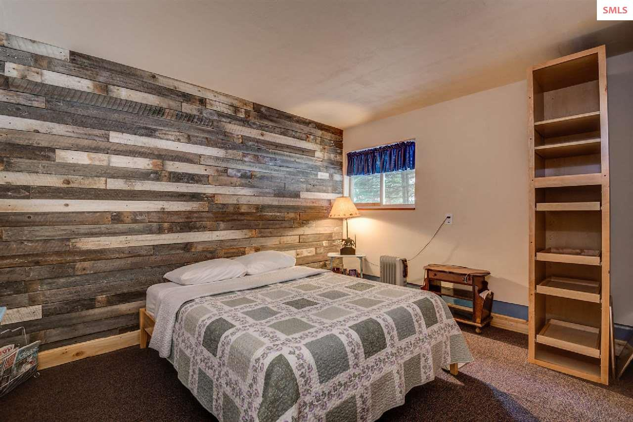 Reclaimed barnwood accents create a cozy cabin fee