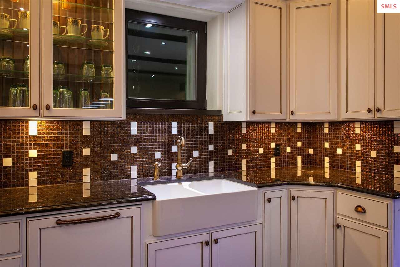 Custom French Cabinets with Tiled Back Splash and