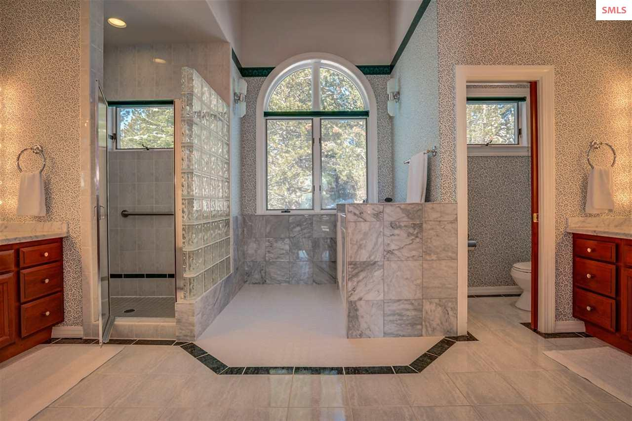 Separate walk-in shower and bath areas are as beau