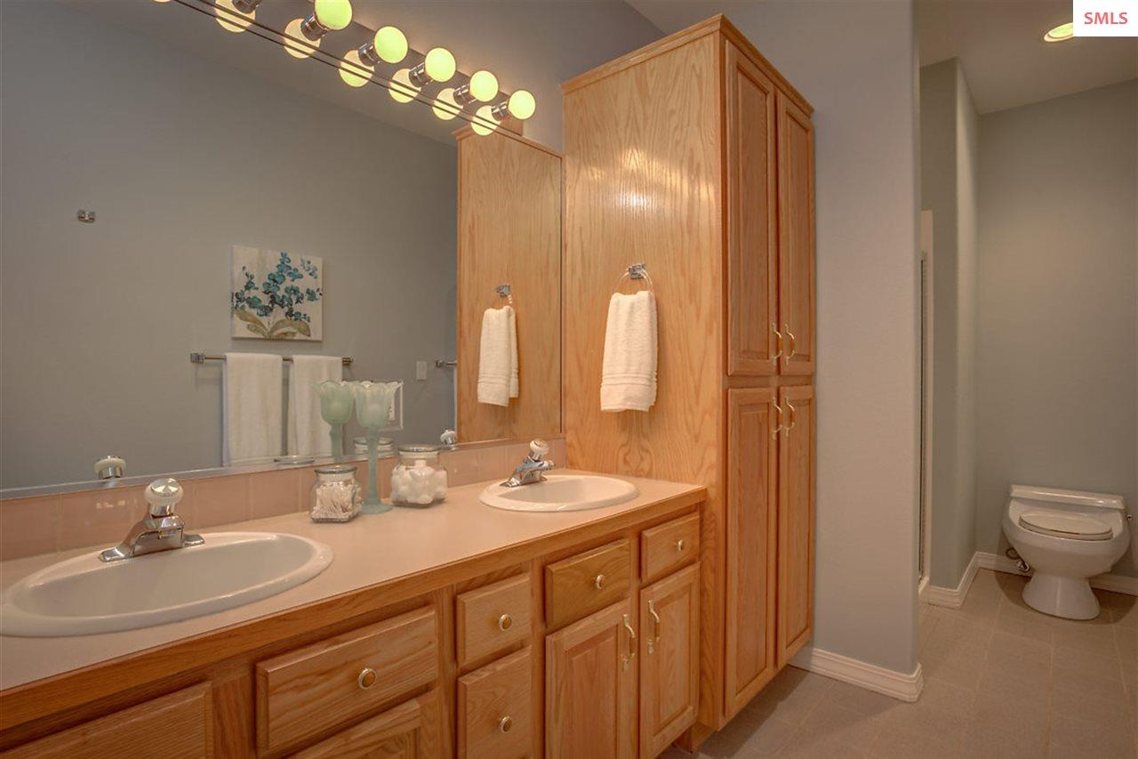 Lower level en suite bathrooms with wood cabinetry