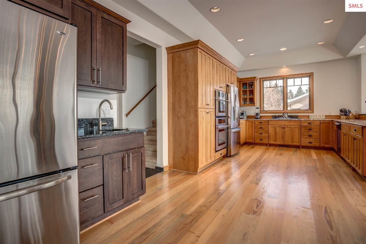 With abundant storage & expansive granite counters