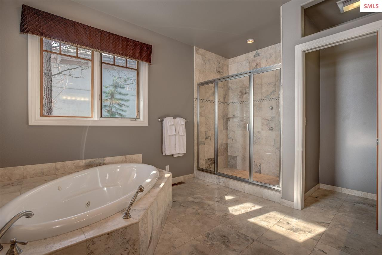 An oversized, glassed shower & private water close
