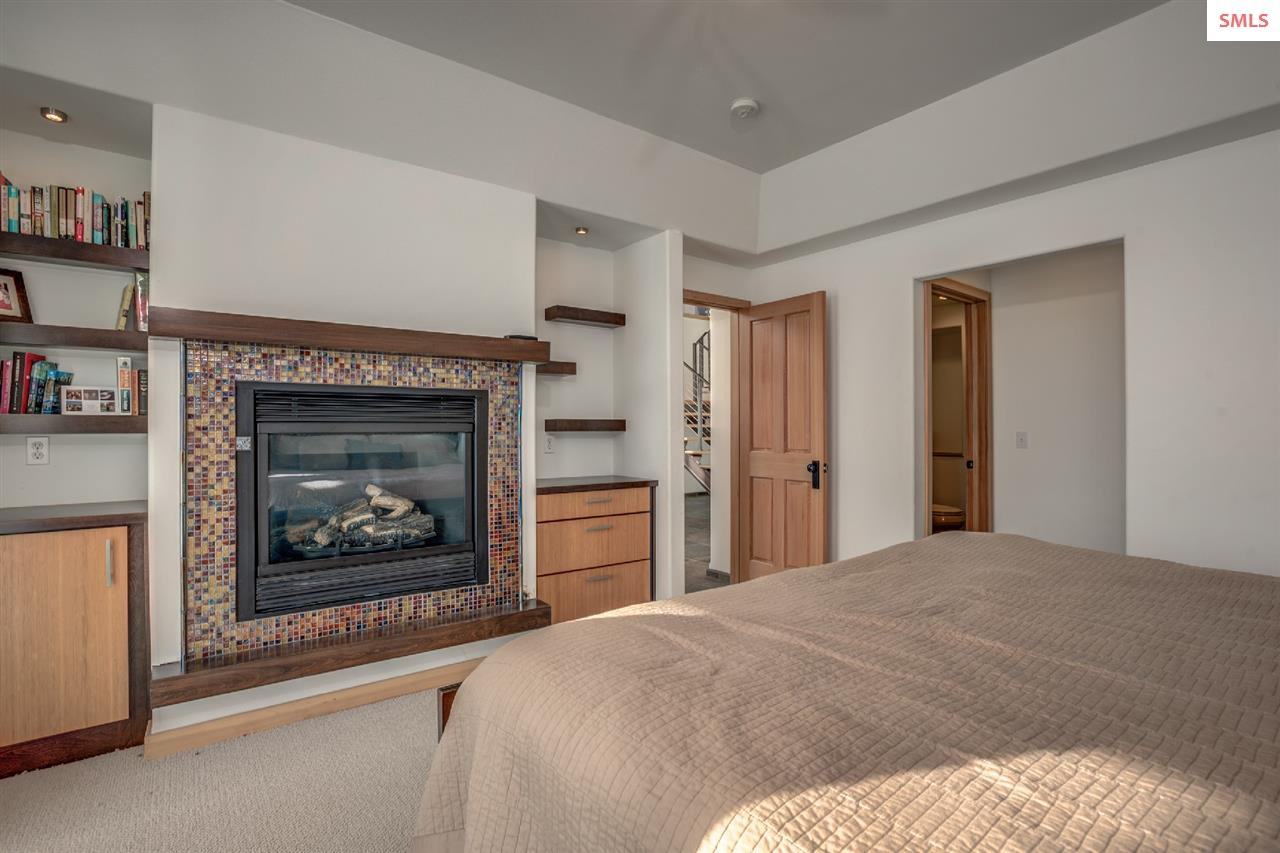 A gas fireplace adds ambience to the guest suite