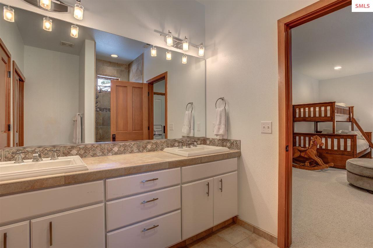 Boasting large closet, dual sinks, and a shower