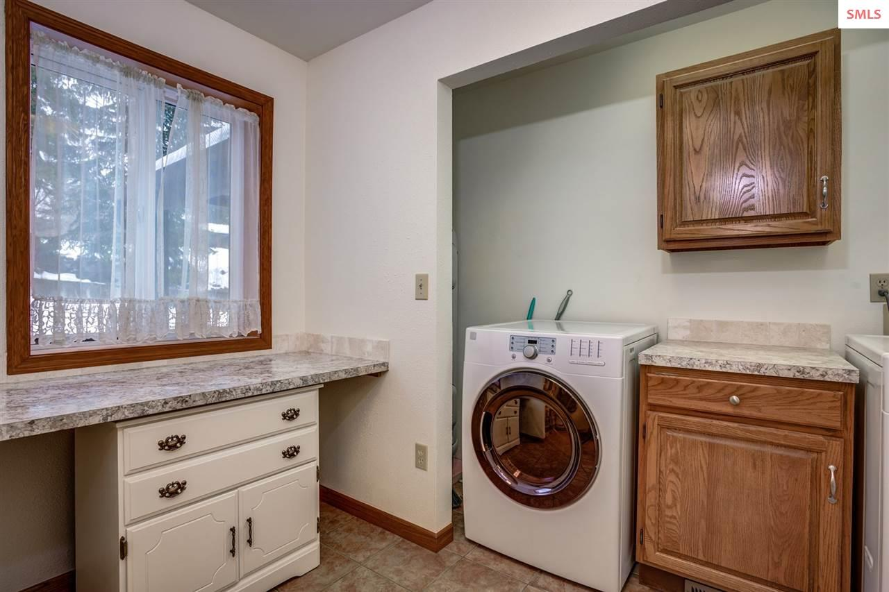 Laundry area in spacious bathroom