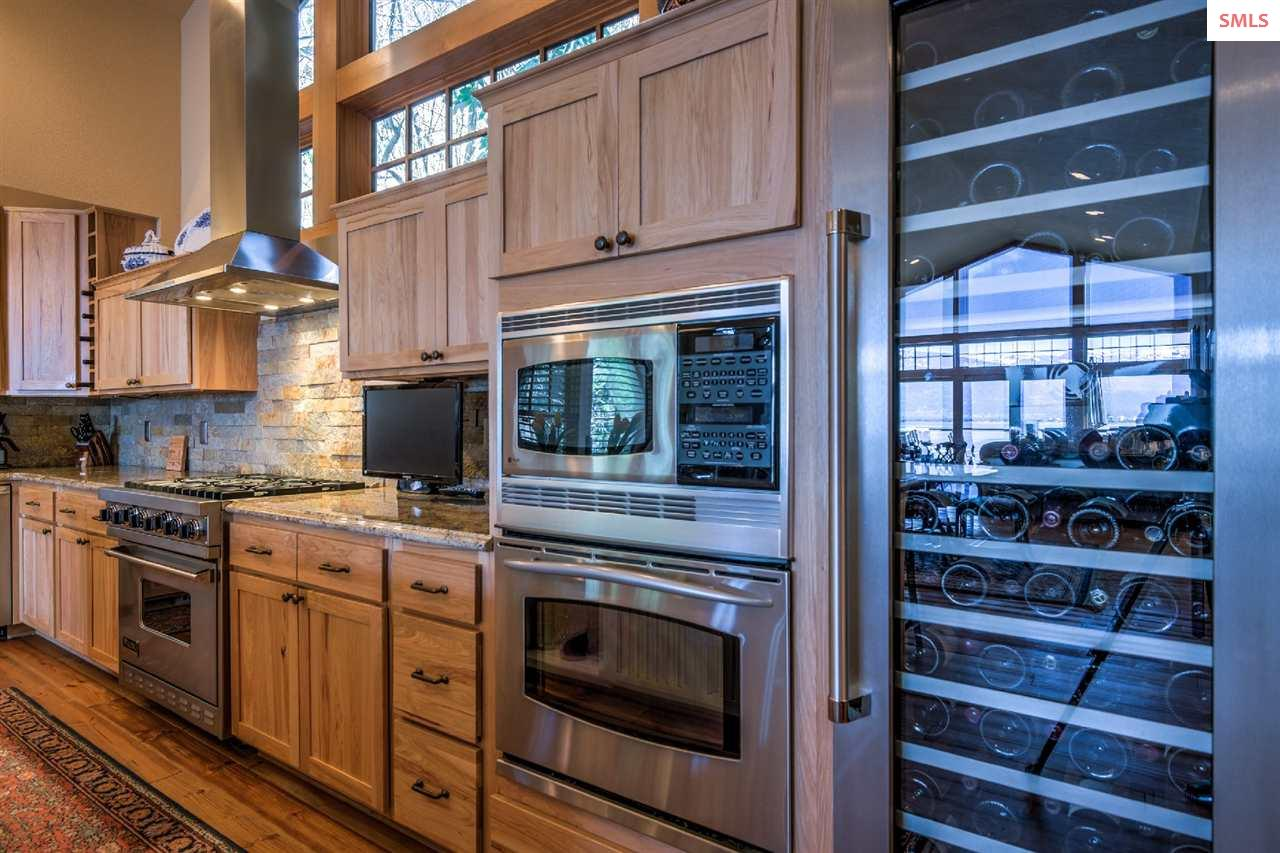 Stainless steel accents the warm wood cabinetry