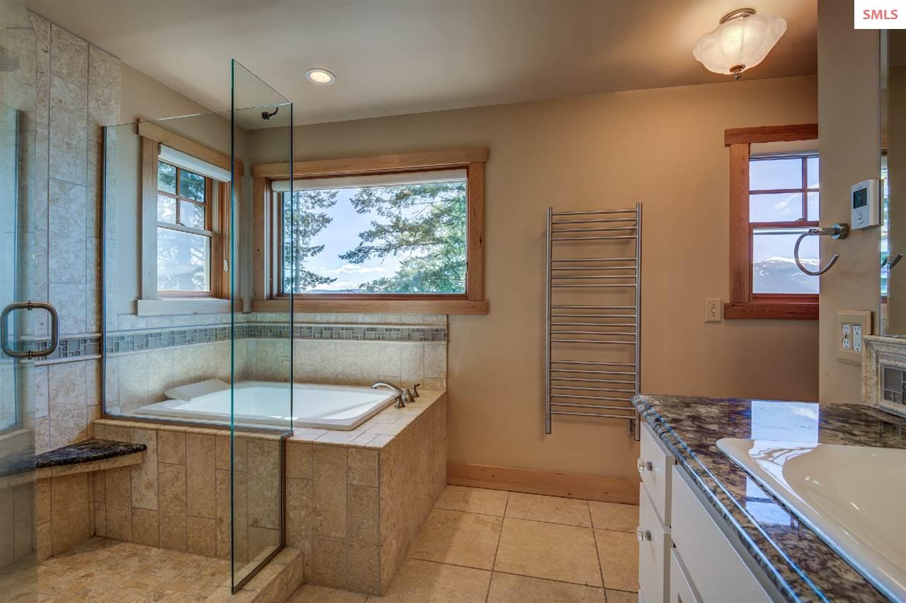 With a soaking tub, heated floors and towel rack,