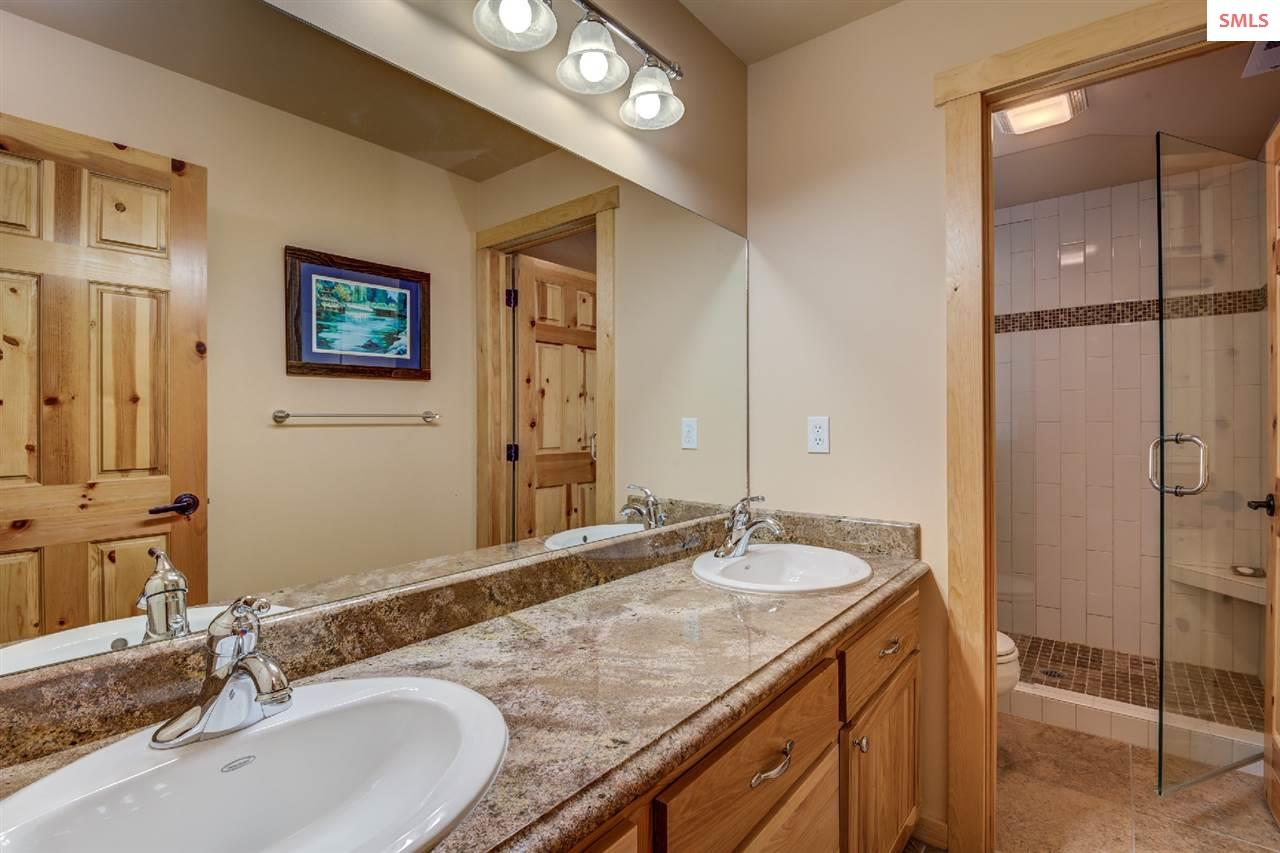 With dual sinks, granite, and tile accents