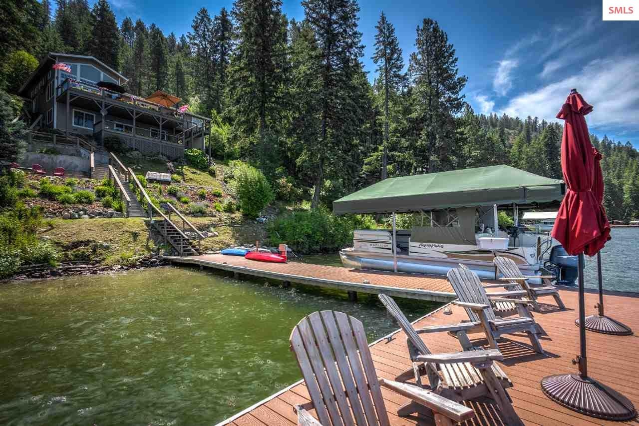 Include a powered boat lift, swim area, & dock for