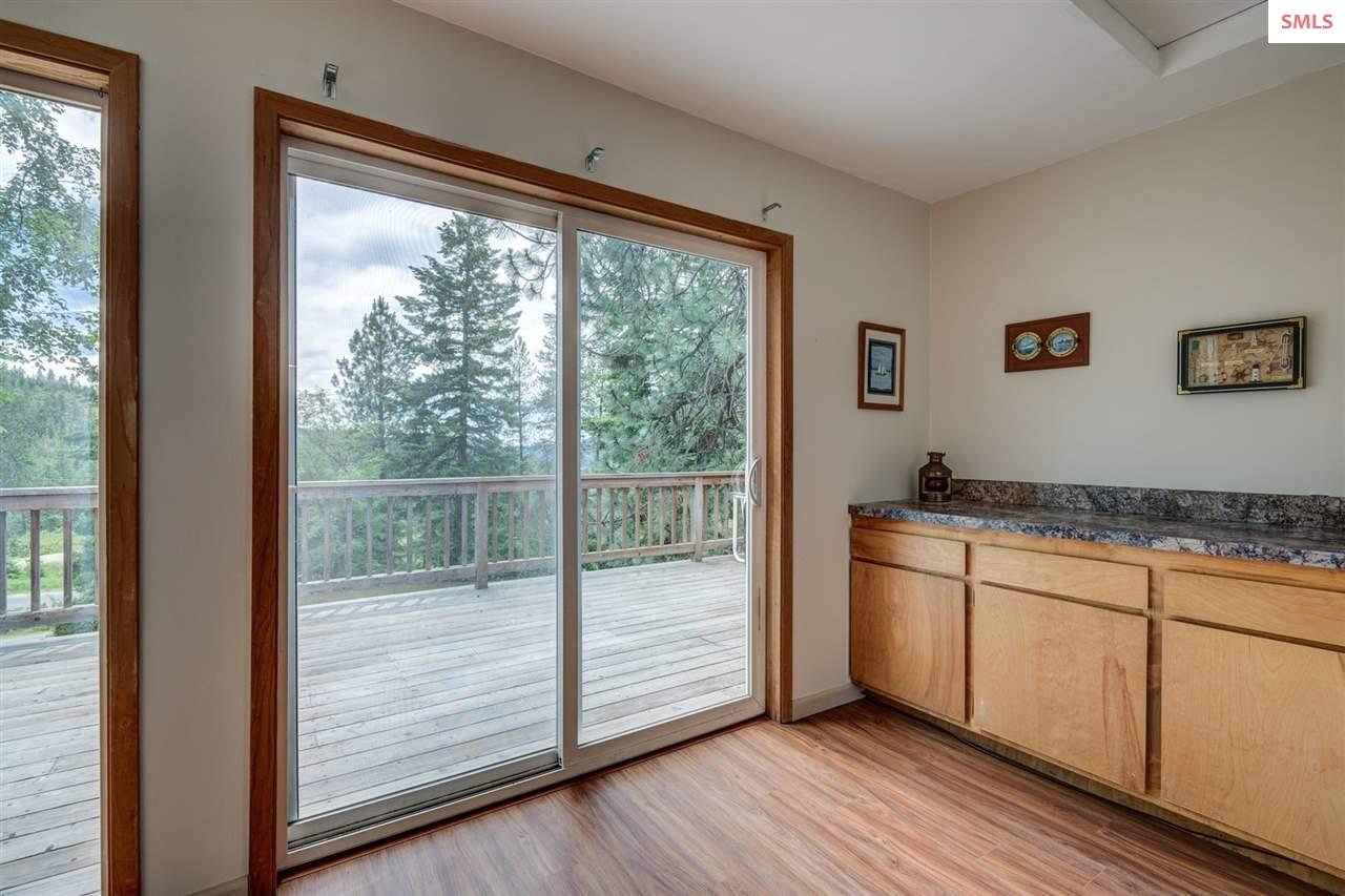 Doors to deck and large window