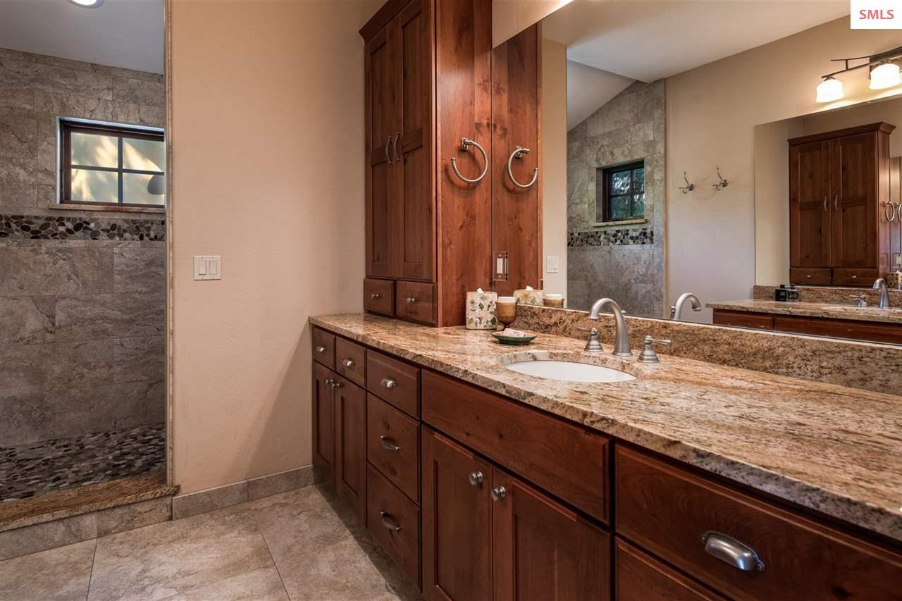 With a walk-in shower and His & Hers vanities.
