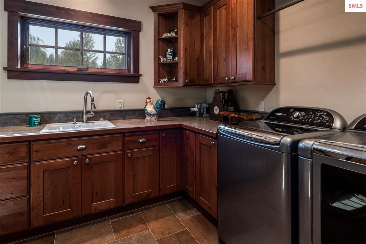 Large with abundant cherry cabinets and counter sp