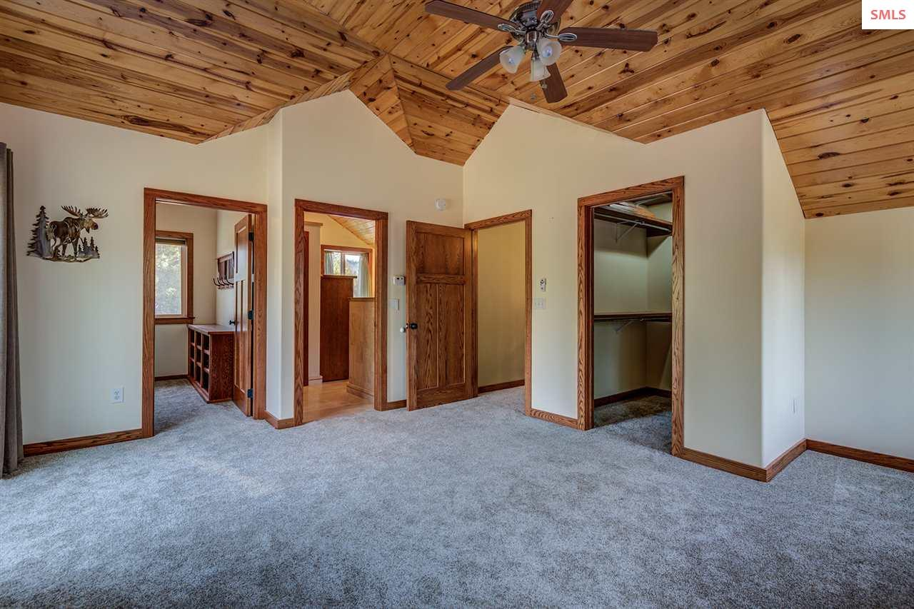 Two walk in closets, master bath and vaulted tongu