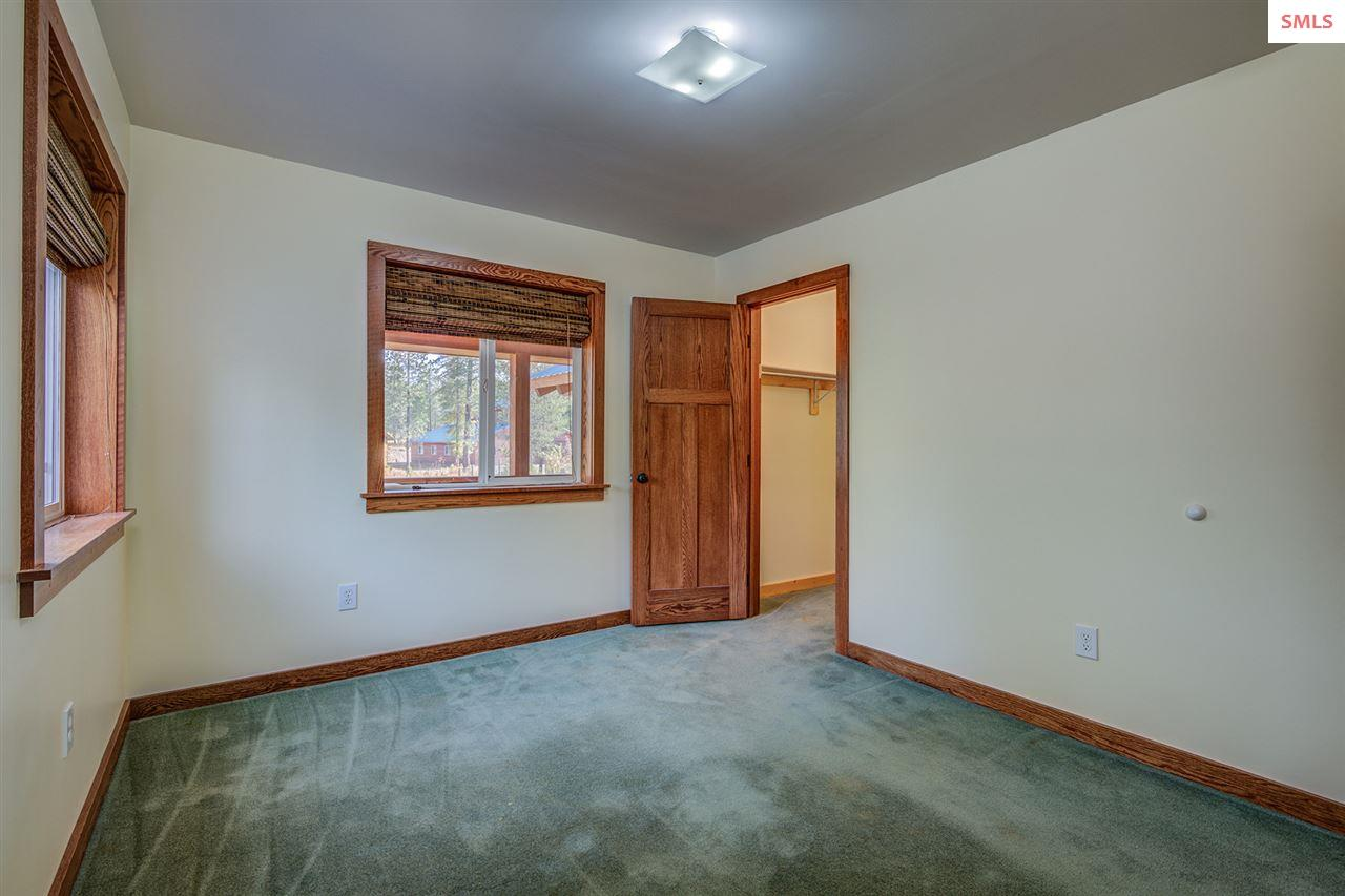 Guest bedroom with natural light and walk-in close