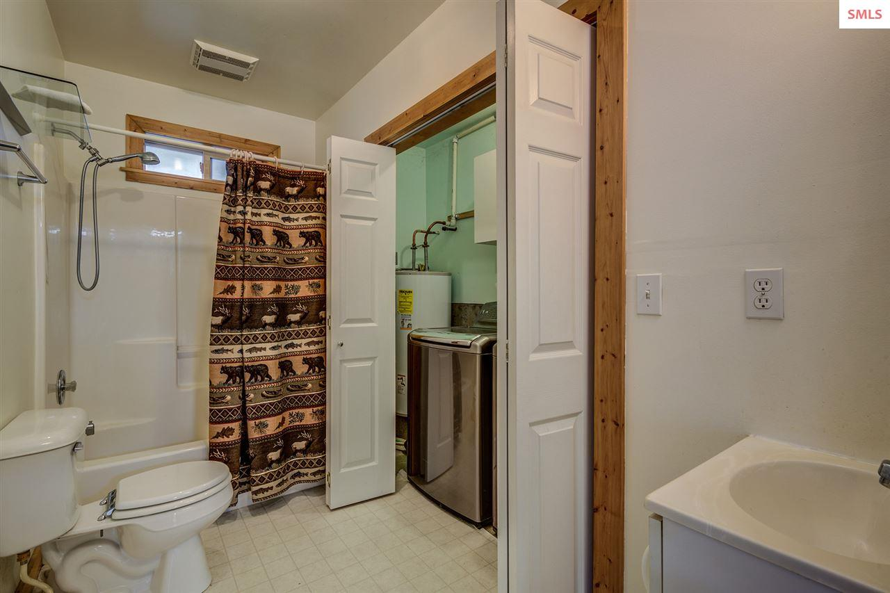 The secondary suite includes a full bath with laun