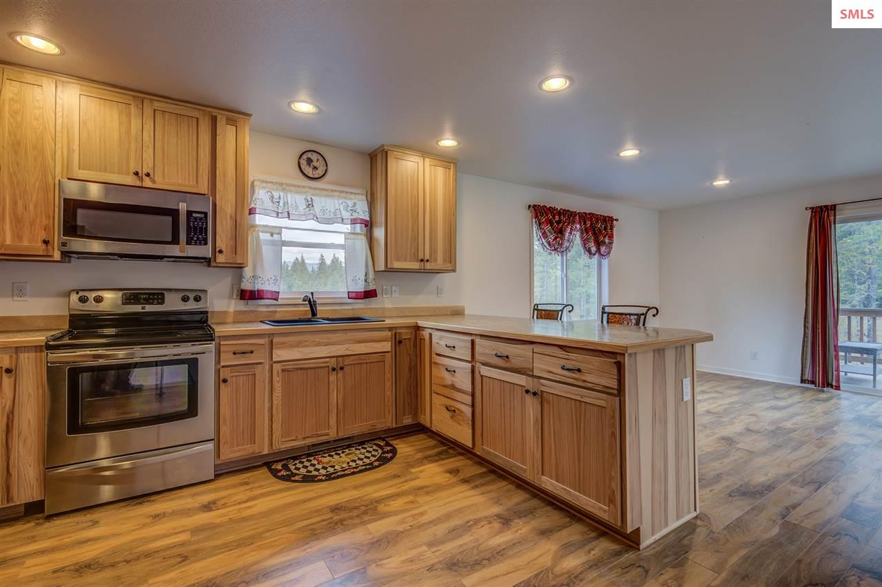 Alder cabinetry, newer appliances and beautiful fl