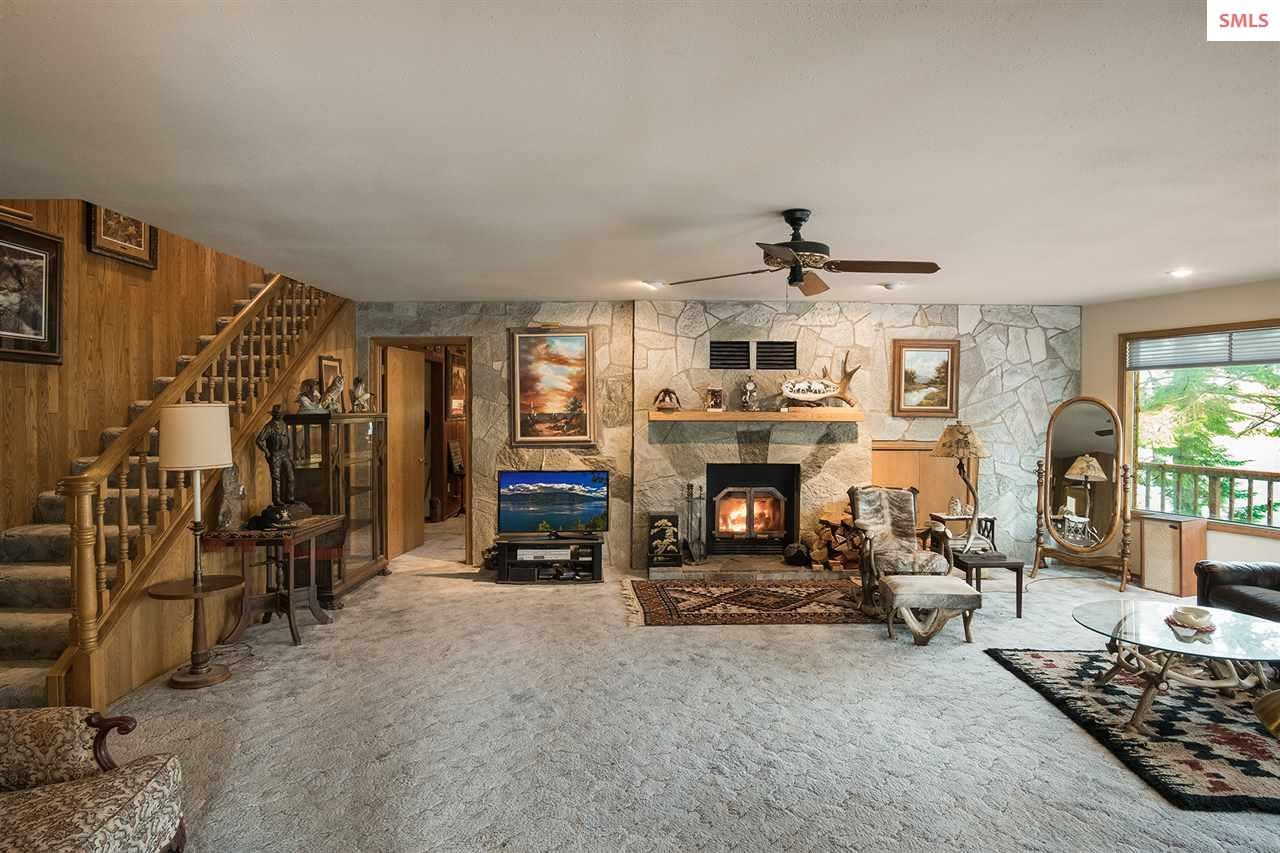 Stone fireplace with wood stove insert