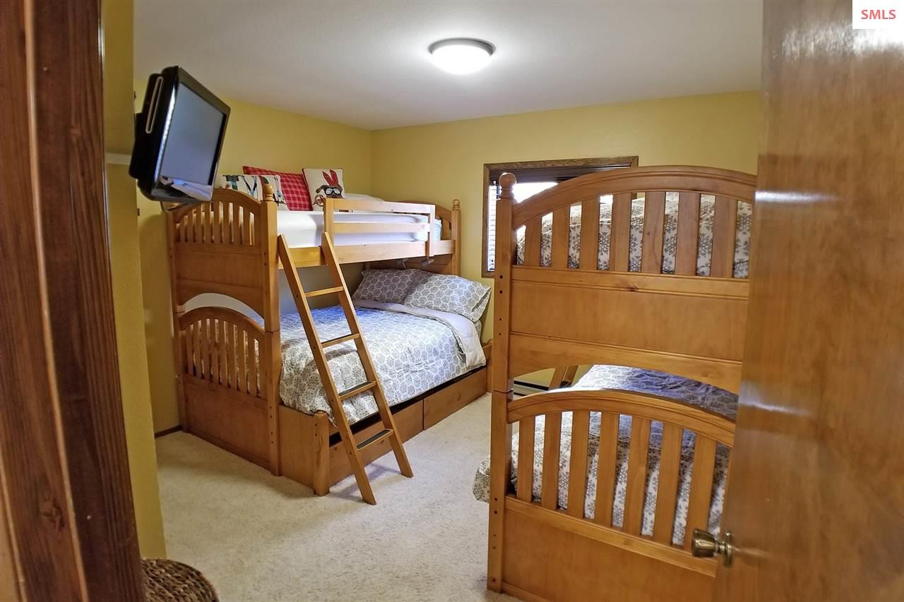Guest room with multiple bunks, closet and wall mo