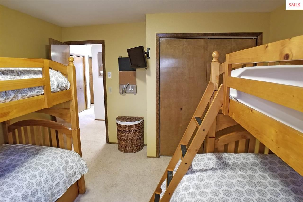 Multiple bunks, closet and wall mount TV
