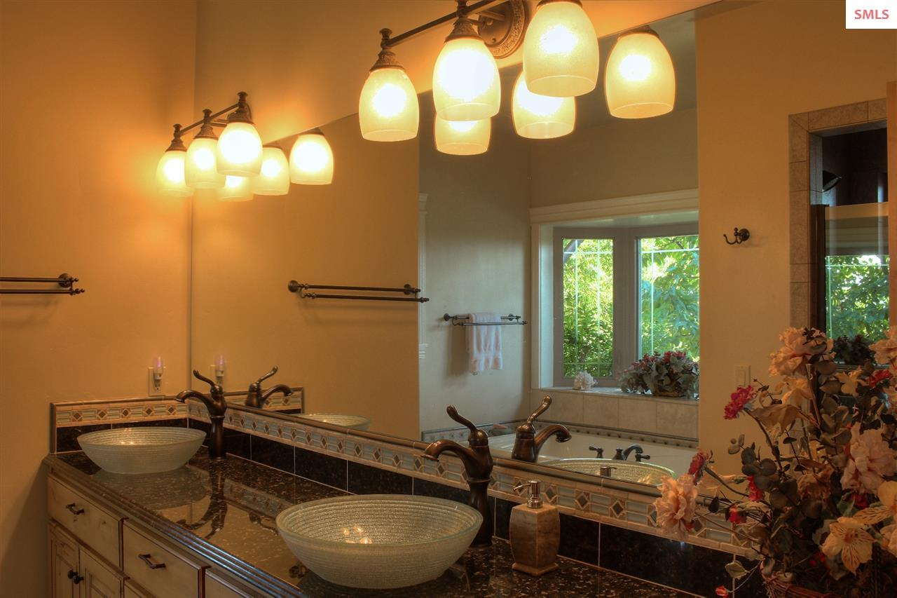 Glass vessel sinks, custom tile, granite.