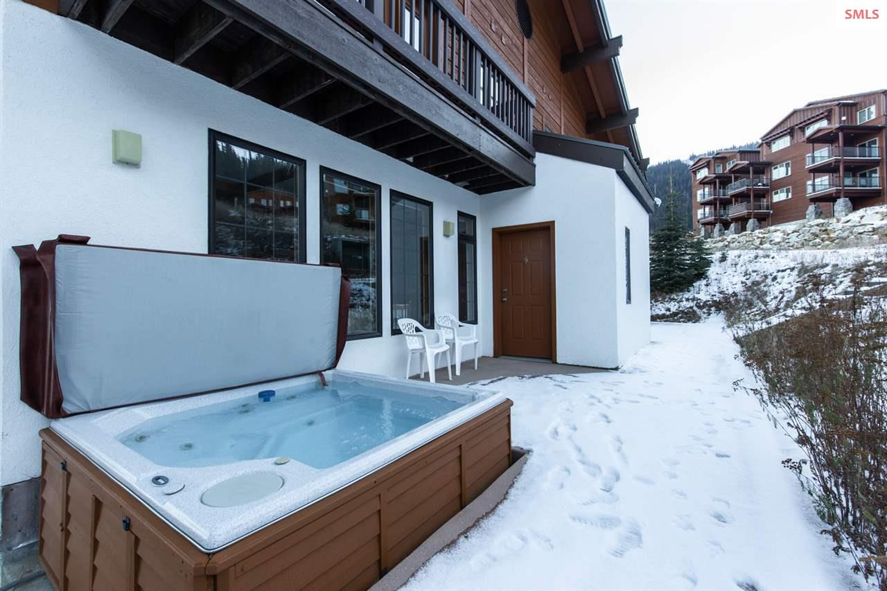 Patio with hot tub for soaking after skiing.