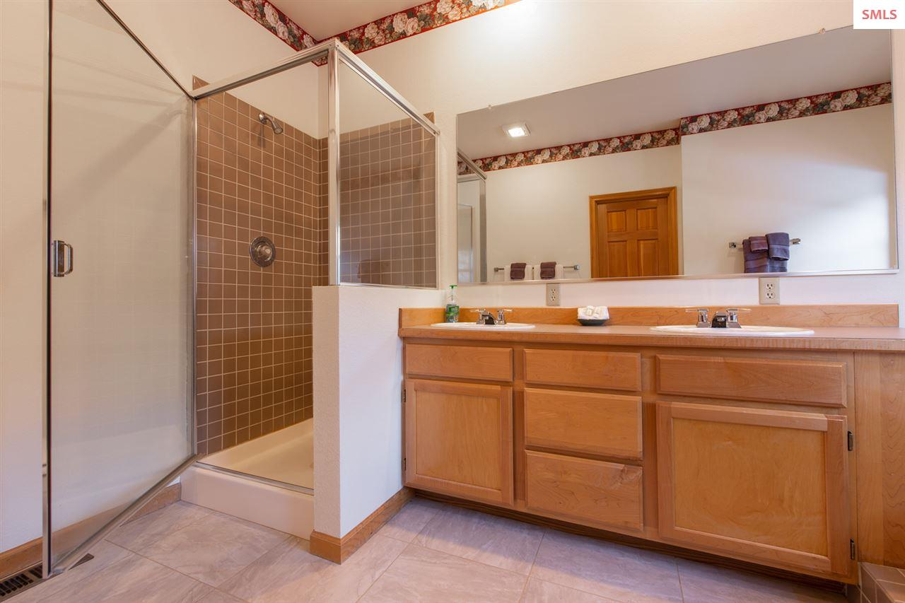 Includes a shower and two sinks.
