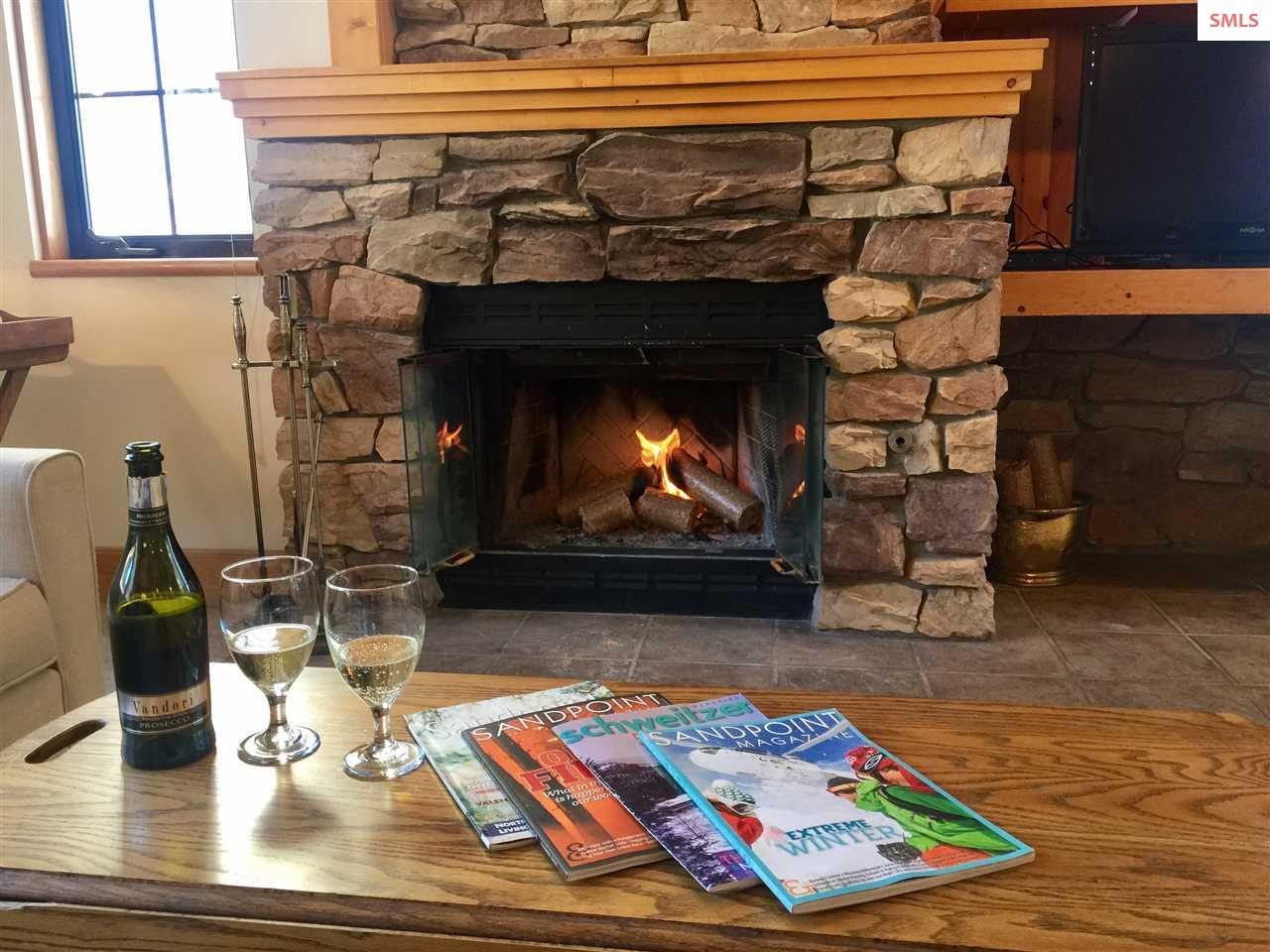 Enjoying the fireplace while watching the skiers.